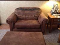 One Seat plus One Oversized Chair with Ottoman. Bought