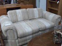 Loveseat Sofa, light beige colors. On consignment for