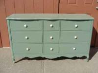 Nine drawer dresser refinished in green with cream