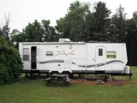 2003 Starcraft 29SKS camper with slide-out (enlarges