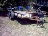 18ft x 7ft lowboy trailer. Breakdown with ramps. Has a