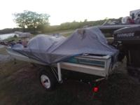1993 17ft. Lowe Bass Boat and motor, 50 horse Evinrude