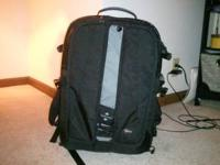 camera bag/ backpack style with lots of.compartments