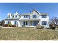 7469 Victoria Lane is a beautiful Colonial in the