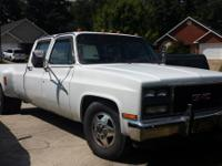 85 gmc dually, lowered, later on model front clip, has