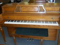 This Lowrey Console piano would make a great starter