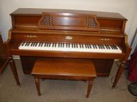 This Lowrey is an elegant console piano. The Lowrey