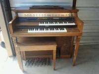 Beautiful pecan wood Lowrey organ. Been well maintained