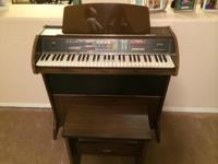 Like new organ with instruction manual and bench