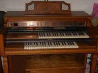 Free Lowrey Organ made of Distressed Pecan wood.