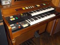 Lowrey electrical organ. Drop in at the establishment &