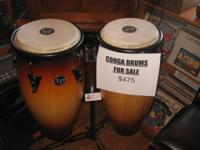 LP Congas (Pair) with $150 stand included. Paid $750