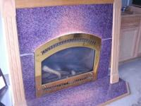 I AM SELLING A GAS FIREPLACE WITH A NICE WOOD MANTEL