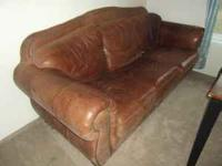 Large leather couch for sale. Asking $155 OBO. Couch is