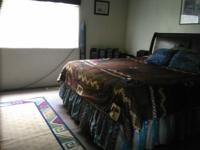 Large master bedroom in upstairs townhouse. Shared