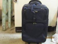 "22"" Very Dark Blue ""Stratus"" Luggage. Has 2 wheels, one"
