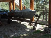Lund 14 FT Boat with camo cover and 4 seats (South