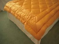 Stunning bright gold satin comforter for a full-size or