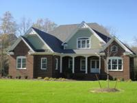 This custom home is situated on an acre plus homesite