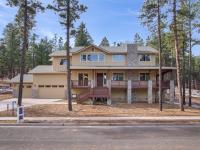 Luxury home in the trees bordering open space and just