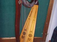Ten year old Lyon and Healy lever folk harp with 34