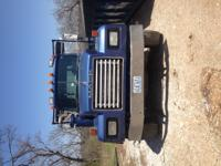 1994 Mack Roll-Off Truck.  Truck has tarp system.  This