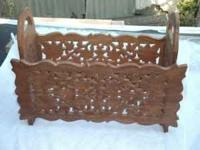 Hand carved magazine holder. Call Ralph at . Thanks.