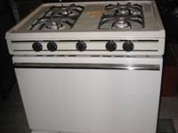 FOR SALE:  MAGIC CHEF GAS STOVE BISQUE IN COLOR.  Gas