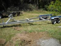 FOR SALE IS A USED MAGIC TILT SMALL BOAT TRAILER.....