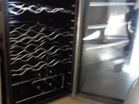 "Black cabinet with silver/chrome accents.  ""Smoked"""