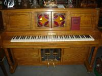 This high end solid oak Aeolian Cabaret Player Piano is
