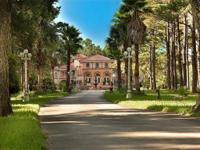 This estate is a MAGNIFICENT EUROPEAN-STYLED MANSION,