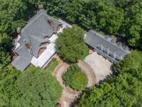 This premier custom gated estate brick house has top of