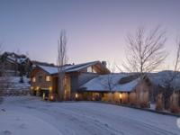Enjoy privacy and incredible ski run views from this