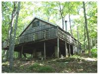47.98+/- Acres. Fully grown wood w/15 acres open,