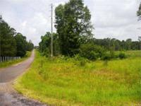 With over 1940 feet of paved road frontage, this tract