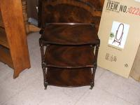 Mahogany 3-tier table on brass casters. Used, good