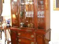 Gorgeous mahogany china cabint with serpentine front,