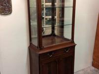 Lovely antique glass display case and cabinet. We paid