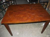 I have a wood table for sale with a mahogany finish.