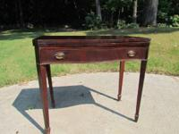 PRICE LOWERED!!  Nice old mahogany game table. Table