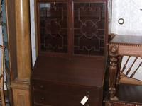Mahogany secretary with 3 drawers and 2 shelves. Used,