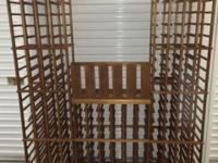 Mahogany wine racks with tasting shelf and glass rack.