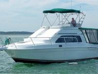 The 1994 Mainship 31 Sedan Bridge is a perfect family