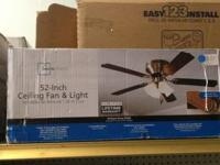 "A Mainstays 52"" ceiling fan w/ light. It has a antique"