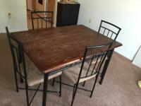 Sturdy steel table with wood top4 chairs with