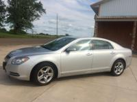 Silver Malibu used as distance commute car. Less than