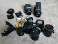 2 cam body's, 4 lenses, 1 extender, 4 backs, and