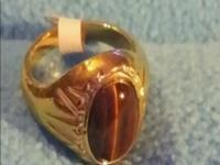 Type:Gemstones This tiger eye stone is aprox 3 carats
