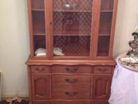 Beautiful maple china cabinet. The glass is carefully
